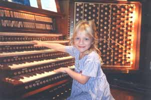 preschooler_plays_the_organ